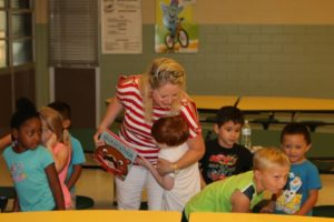 Carmen hugging a reading buddy at Taylor ISD